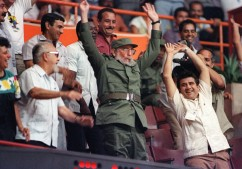 "Cuban president Fidel Castro (C) participates in the ""wave"" while watching the Pan American games women's basketball semi-final between Cuba and the United States of America, 10 August 1991, in the Latinoamericano stadium. Cuba won 86-81."