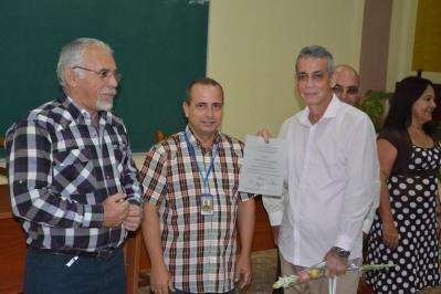 Pedro Antonio Machín Armas recibe su Título de Doctor en Ciencias, en acto efectuado en la sede José de la Luz y Caballero de la Universidad de Holguín, el 30 de mayo de 2018. UHo FOTO/Luis Ernesto Ruiz Martínez.